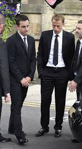 david beckham pays respects to gary and phil neville s father at the family are incredibly close and mr neville had been a mentor to his sons