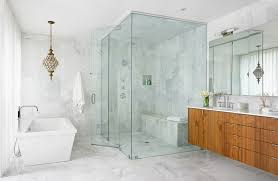 small glass shower room with elegant laminate floating vanity and white marble floor tile