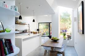 view in gallery dark pendant lights stand out thanks to the white kitchen backdrop