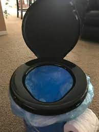 luggable loo snap on toilet seat with