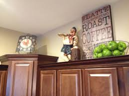 image of decorating above kitchen cabinets tuscan style