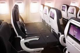 with the adjustable footrests up the skycouch seats on an air new zealand 777 200 aircraft extend to create the innovative bed structure