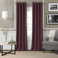 elegant grommet curtains with l shaped curtain rod and wainscoting panels plus drum pendant lighting and gray ikea accent chair also marble top coffee table