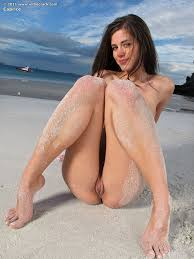 Sexy brunette Caprice strips bikini to flaunt nice tits spread.