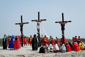 thousands of catholic devotees witnessed dozens of men who were nailed to wooden crosses or flogged