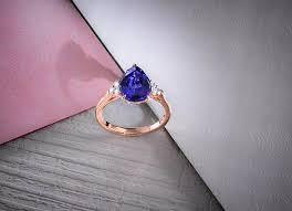 tanzanite pear side stone ring 2 74ct tw