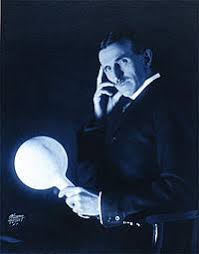 radiation astronomy radios wikiversity is pictured holding a gas filled phosphor coated light bulb which he developed in the 1890s and was illuminated out wires by an electromagnetic