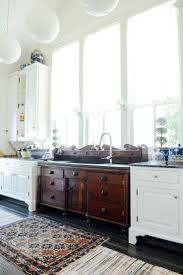 i love that they used a dresser for the kitchen sink kitchen