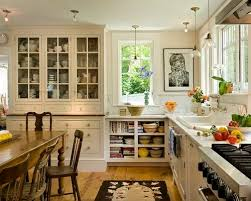 lighting above kitchen sink. farmhouse eatin kitchen idea in burlington with a dropin sink open lighting above