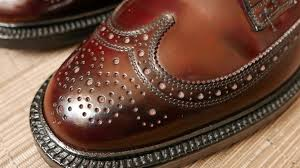 the soles are 0 5 thick and the pair has a stacked leather heel with an embedded steel plug the welt stitching is well done