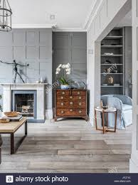 Antique Chest In Open Plan Living Room With Wall Panelling And