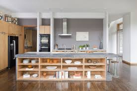 gray marble countertop island with open shelves black side by side refrigerator gray vase wooden kitchen cabinets