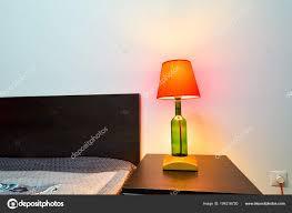 Lamp Een Nachtkastje Naast Een Bed Stockfoto Brszattila At Gmail