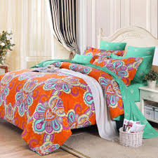 bohemian style bedroom design with chic western paisley print duvet orange turquoise green comforter color
