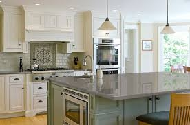 white kitchen cabinets with grey quartz countertops