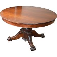 round oak coffee table with claw feet