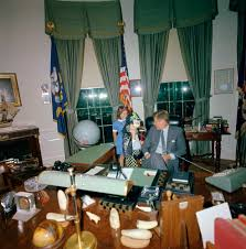 jfk in oval office. Kennedy Visits With His Daughter, Caroline (speaking On Telephone, Wearing Halloween Costume), And Niece, Maria Shriver, In The Oval Office Of Jfk K