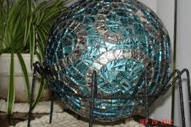 custom made stained glass mosaic gazing ball in van gogh blue with copper and mirrored jewels