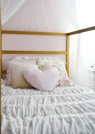adorable diy shabby chic inspired bedding in pink gold and white for a girls room