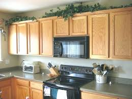 how to decorate top of kitchen cabinets agreeable enclose space above kitchen cabinets organization s how