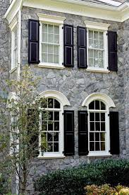 exterior vinyl pediments. arch over lower storey windows as a contrast to upper pediments. exterior vinyl pediments s