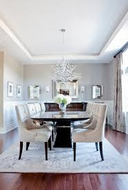 off white room dining room transitional with white wainscoting d pendant lights