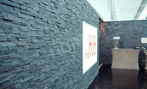 natural stacked stone veneer example on interior wall using norstone charcoal rock panels