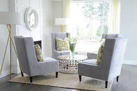 yellow and gray living room with chairs in circulation formation