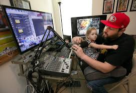 ralph barrera american statesmanbrandon phariss looks over equipment he uses to broadcast on twitch which holding his nearly 2 year old daughter brynlee