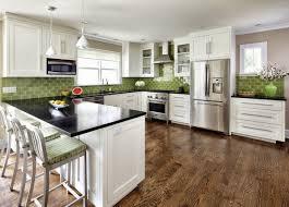 green tile backsplash wood flooring black countertops marble laminate white kitchen