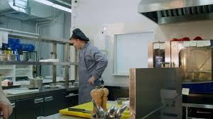 busy restaurant kitchen. Three Busy Male Cooks Working In The Restaurant Kitchen N