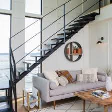 Contemporary Black and White Living Room with an Open Staircase