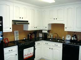 white cabinets black appliances gallery of kitchen