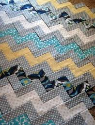 Zig Zag Chevron Quilt using only rectangles- no sewing triangles ... & Zig Zag Quilt Piecing - she explains very simply how this is achieved. You  could alter it to use wider strips and make bigger blocks so it's a bolder  look ... Adamdwight.com