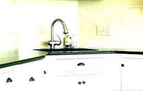 colored glass subway tile backsplash cream color with gray grout brown colo