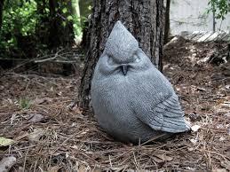 bird statue concrete bird outdoor