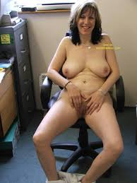 Nude woman in the office