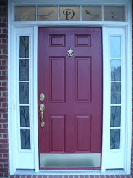 glass front door with side panel at red wooden door