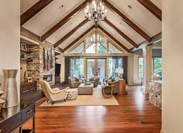 living room with cathedral wood beamed ceiling