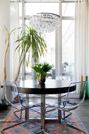 houzz chandelier dining room eclectic with round dining table clear chairs