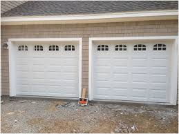haas model 680 steel raised panel garage doors in white with cascade glass installed by