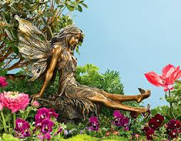 garden fairy statues. Large Garden Fairy With Butterfly Basking In The Sunlight, A Graceful Slowly Stretches - And Joins Her! Holding Still, She Admires Statues