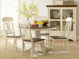 white round pedestal dining table with wooden dining chairs design for country style dining room furniture