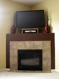 corner fireplace designs with tv above fire place and pits