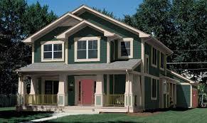 green house white trim black shutters