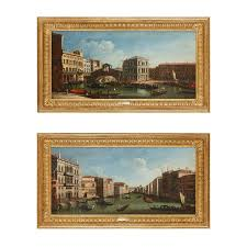 two venetian vedute oil paintings in giltwood frames after cana