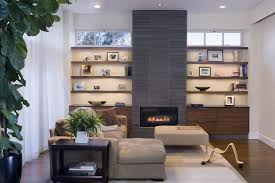 built in next to fireplace living room contemporary with sectional sofa floating shelves tile fireplace surround