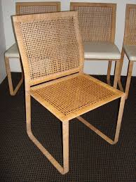 20th century rare harvey probber woven rattan dining chairs