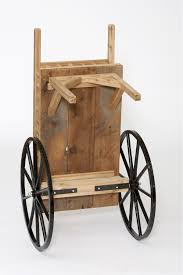 the peddler cart is made with 3 4 thick red cedar the wheel spokes are made with hickory wood which is painted black and the wheel rim and hub are cast