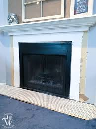 i m working on updating a boring fireplace with a farmhouse style starting with tiling